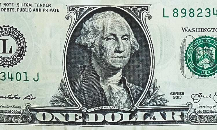 The face of George Washington, the first United States president, on a green one dollar bill